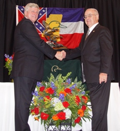 Bruce Lewis presents Cross (right) with award