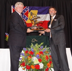 Bruce Lewis presents Will Primos (right) with award