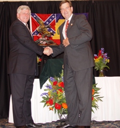 Bruce Lewis presents Bill Sugg Jr. (right) with award