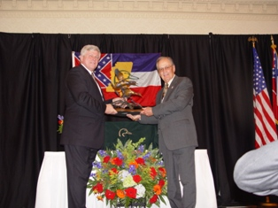 Bruce Lewis presents Melvin Tingle (right) with award