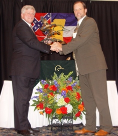 Bruce Lewis presents Haas (right) with award