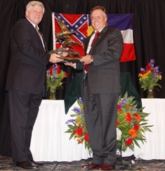 Bruce Lewis presents Rick Kaminski (right) with award