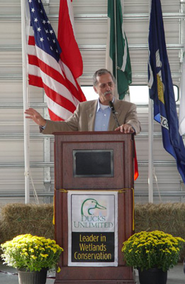 Terry Steinwand, director of the North Dakota Game and Fish Department and representative of the North American Wetlands Conservation Council, addresses the crowd at the Black Lake Terracing Project.
