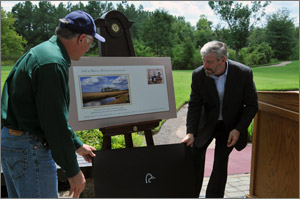 Interior Secretary Ken Salazar and DU CEO Dale Hall unveil the new Federal Duck Stamp cachet