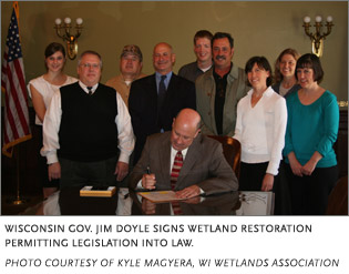Gov. Doyle signs the wetlands restoration permitting legislation into law in Wisconsin