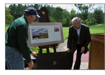 Interior Secretary Ken Salazar and DU CEO Dale Hall unveil the new Duck Stamp cachet