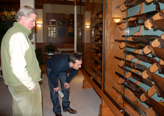 Reynolds (left) and Hautman view one of the few complete sets of Ducks Unlimited dinner guns dating from 1973 to 2009. The collection was donated by DU member Tony Palermo.